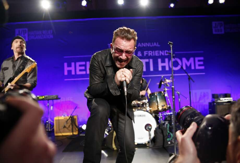 Bono performs on stage at the 3rd Annual Sean Penn & Friends HELP HAITI HOME Gala on Saturday, Jan. 11, 2014 at the Montage Hotel in Beverly Hills, Calif. Photo: Colin Young-Wolff, Associated Press
