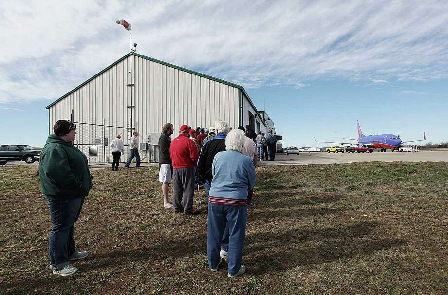 People gather at M. Graham Clark Airport in Hollister, Mo., to see the Southwest jet that landed by mistake. It should have landed at Branson Airport on Sunday. Photo: Valery Mosley, MBR / Valerie Mosley/News-Leader