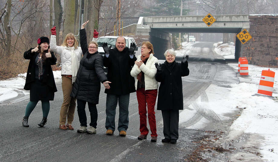 Staffers at the Pequot Library -- playing in traffic -- celebrate reopening of Westway Road, an access street to the library at 720 Pequot Ave., on Friday after completion of a railroad construction on the span allowed the street to be fully reopened last Friday. Photo: Contributed Photo / Fairfield Citizen contributed
