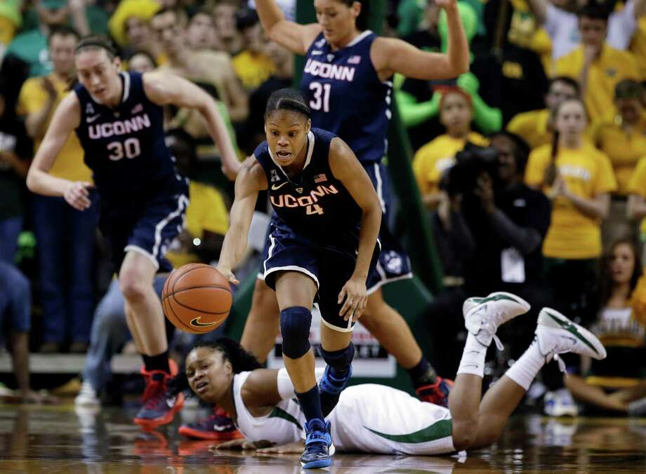 Connecticut guard Moriah Jefferson (4) comes away with a loose ball as Baylor guard Odyssey Sims, bottom, watches in the first half of an NCAA college basketball game, Monday, Jan. 13, 2014, in Waco, Texas. Photo: Tony Gutierrez, AP / Associated Press