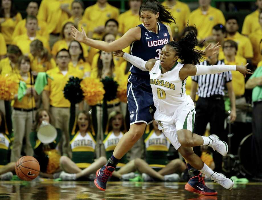 Baylor guard Odyssey Sims (0) loses the ball trying to get around Connecticut's Stefanie Dolson (31) in the first half of an NCAA college basketball game, Monday, Jan. 13, 2014, in Waco, Texas. Photo: Tony Gutierrez, AP / Associated Press