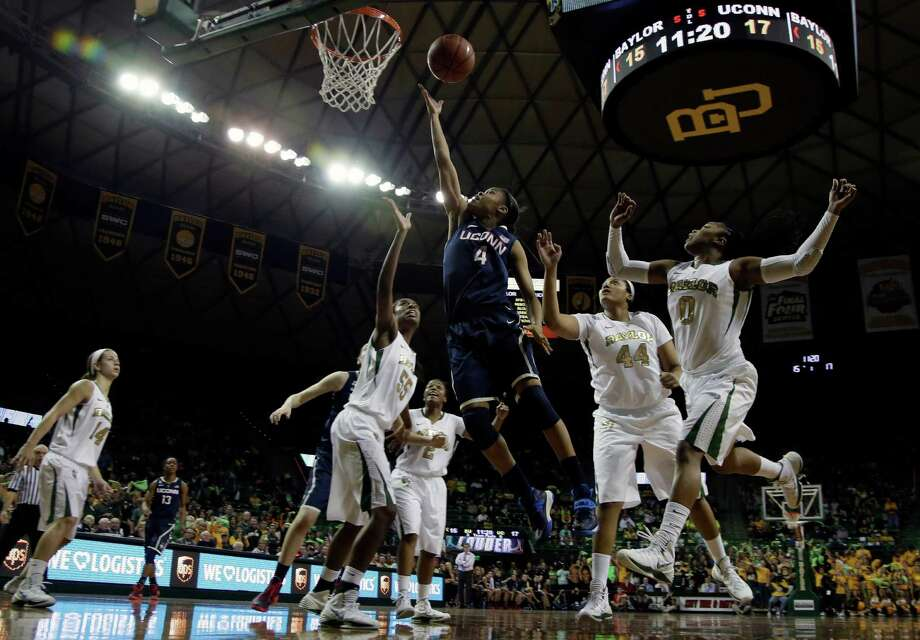 Connecticut guard Moriah Jefferson (4) goes up for a shot surrounded by Baylor's Khadijiah Cave (55), Kristina Higgins (44) and Odyssey Sims (0) in the first half of an NCAA college basketball game, Monday, Jan. 13, 2014, in Waco, Texas. Photo: Tony Gutierrez, AP / Associated Press