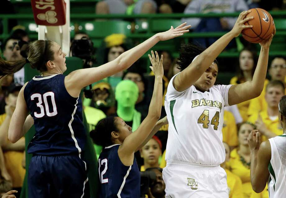Connecticut's Breanna Stewart (30) and Saniya Chong, center, compete for a rebound against Baylor's Kristina Higgins (44) in the first half of an NCAA college basketball game, Monday, Jan. 13, 2014, in Waco, Texas. Photo: Tony Gutierrez, AP / Associated Press