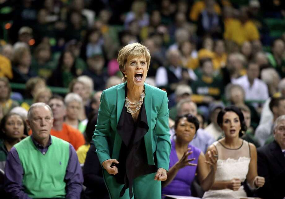 Baylor head coach Kim Mulkey instructs her team on defense during the first half of an NCAA college basketball game against Connecticut, Monday, Jan. 13, 2014, in Waco, Texas. Photo: Tony Gutierrez, AP / Associated Press