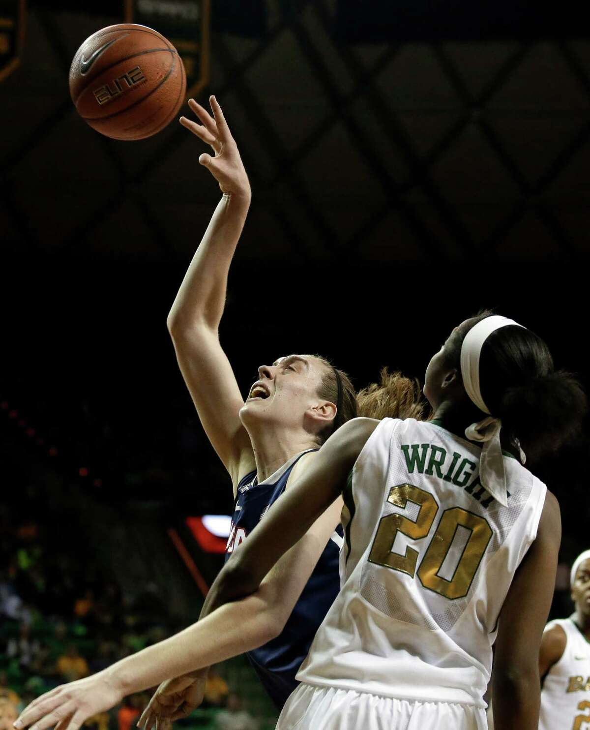 Connecticut's Breanna Stewart, left, fights her way to a shot opportunity against Baylor's Imani Wright (20) in the first half of an NCAA college basketball game, Monday, Jan. 13, 2014, in Waco, Texas.