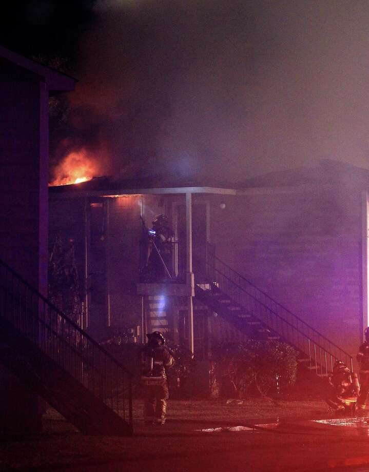 Pasadena firefighters battle an apartment fire at 6565 Spencer Highway in Pasadena on Monday. Photo: Karen Warren, Houston Chronicle / © 2013 Houston Chronicle
