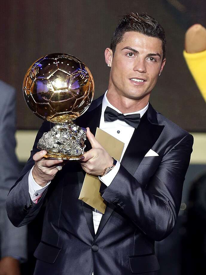 Cristiano Ronaldo of Portugal picks up his second Ballon d'Or, or Golden Ball, after winning in a close vote over Lionel Messi. Photo: Michael Probst, Associated Press