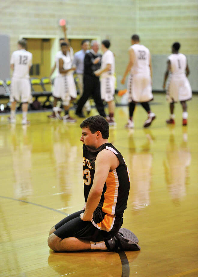 Brunswick's Billy O'Malley reacts after losing to Hopkins, 60-58, in the final seconds of their basketball game at Brunswick School's Simpson Athletic Center in Greenwich, Conn., on Monday, Jan. 13, 2014. Photo: Jason Rearick / Stamford Advocate