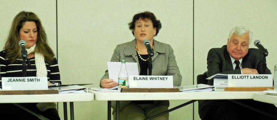 Board of Education chairwoman, Elaiine Whitney, center, gave a brief update on the status of the school district's health insurance fund, which has a $2 million shortfall, during a BOE meeting Monday at Staples High School. Whitney also appointed two citizen members to the board's ad hoc committee looking into the matter. At left, is board member Jeannie Smith, to the far right is Superintendent of Schools Elliot Landon. Photo: Anne M. Amato / Westport News