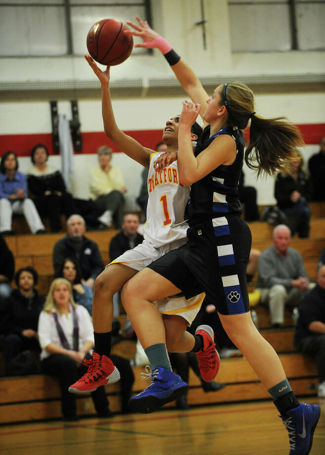 Bunnell's Jill Pastor looks for the block as Stratford's Destani Brantley drives to the basket during their girls basketball matchup at Stratford High School in Stratford, Conn on Monday, January 13, 2014. Photo: Brian A. Pounds / Connecticut Post