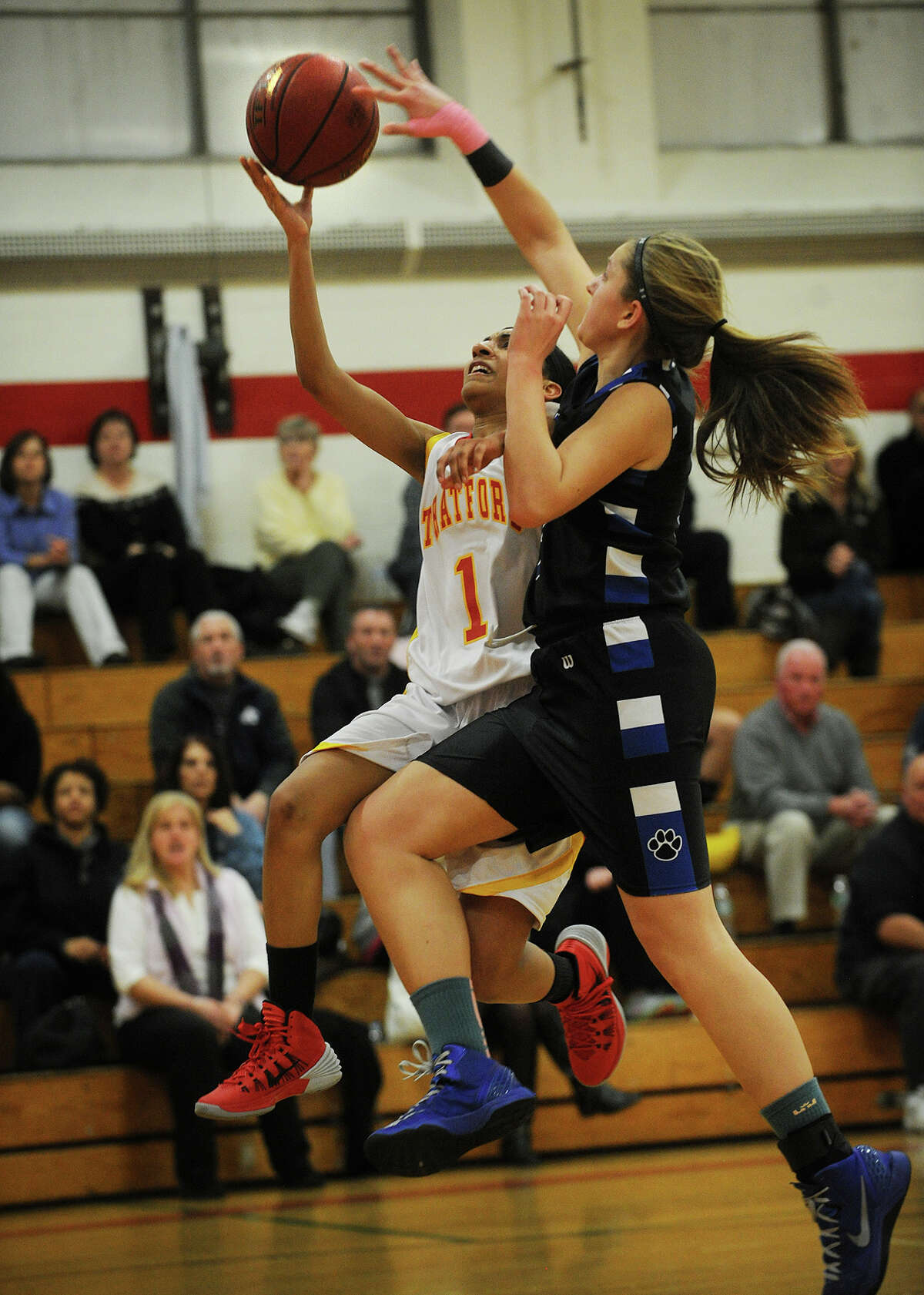 Bunnell's Jill Pastor looks for the block as Stratford's Destani Brantley drives to the basket during their girls basketball matchup at Stratford High School in Stratford, Conn on Monday, January 13, 2014.