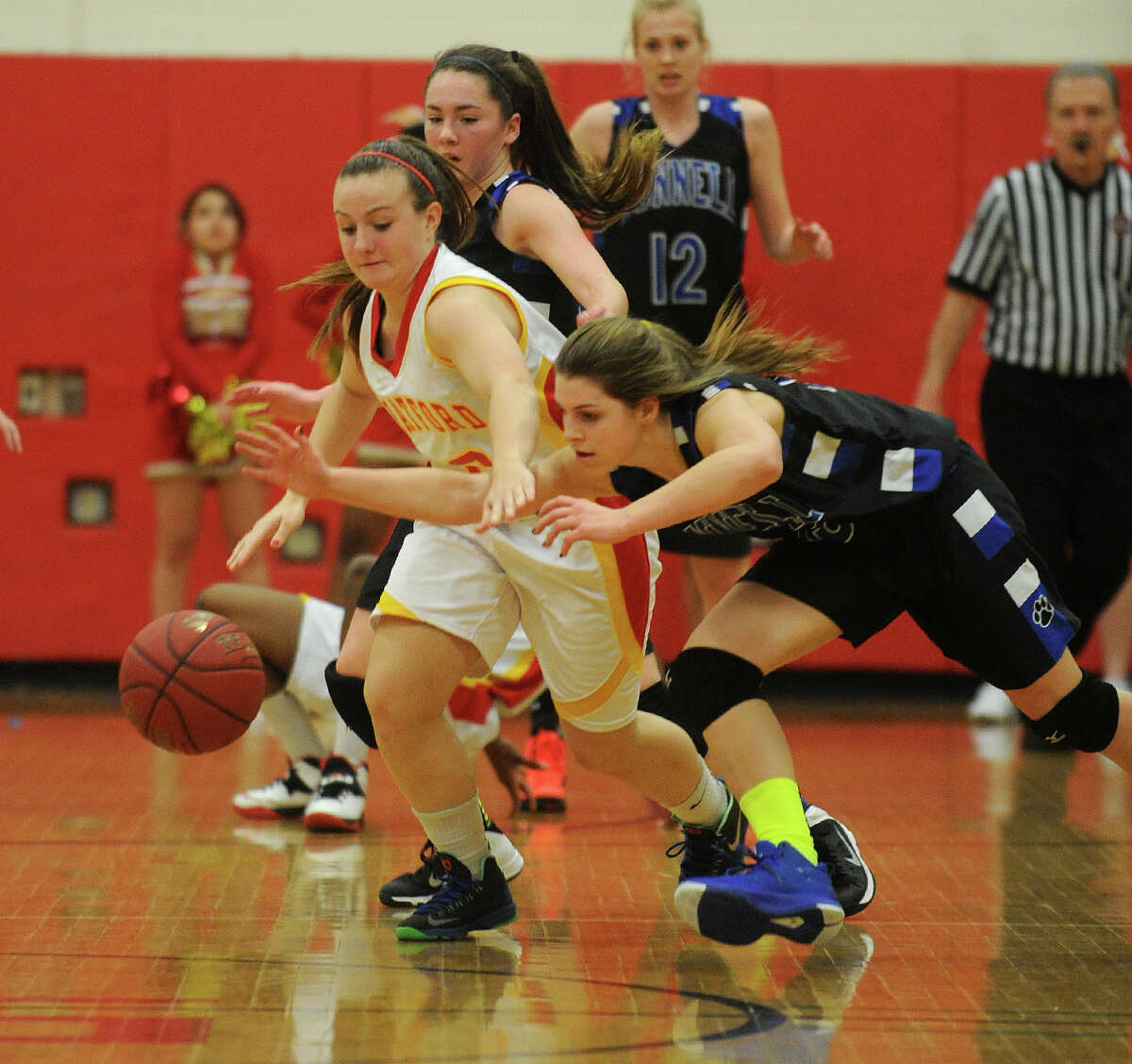 Stratford's Rebecca McMahon, left, chases down a loose ball with Bunnell's Caitlin Carrafiello during their girls basketball matchup at Stratford High School in Stratford, Conn on Monday, January 13, 2014.