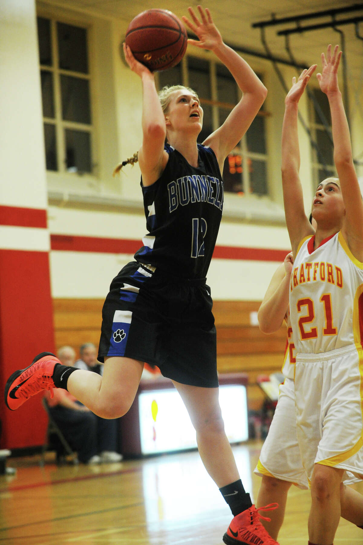 Bunnell's Shannon Hofmiller, left, shoots while defended by Stratford's genesis Torres during their girls basketball matchup at Stratford High School in Stratford, Conn on Monday, January 13, 2014.