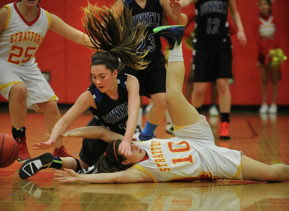 Bunnell's Caitlin Carrafiello, left, and Stratford's Rebecca McMahon dive after a loose ball during their girls basketball matchup at Stratford High School in Stratford, Conn on Monday, January 13, 2014. Photo: Brian A. Pounds / Connecticut Post
