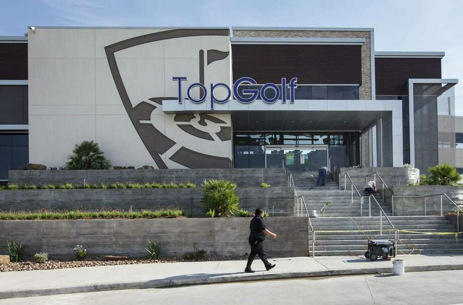TopGolf's Houston facility features 102 golf bays on three floors and a rooftop terrace. Photo: Photos By Michael Paulsen / Houston Chronicle / 2012 Houston Chronicle