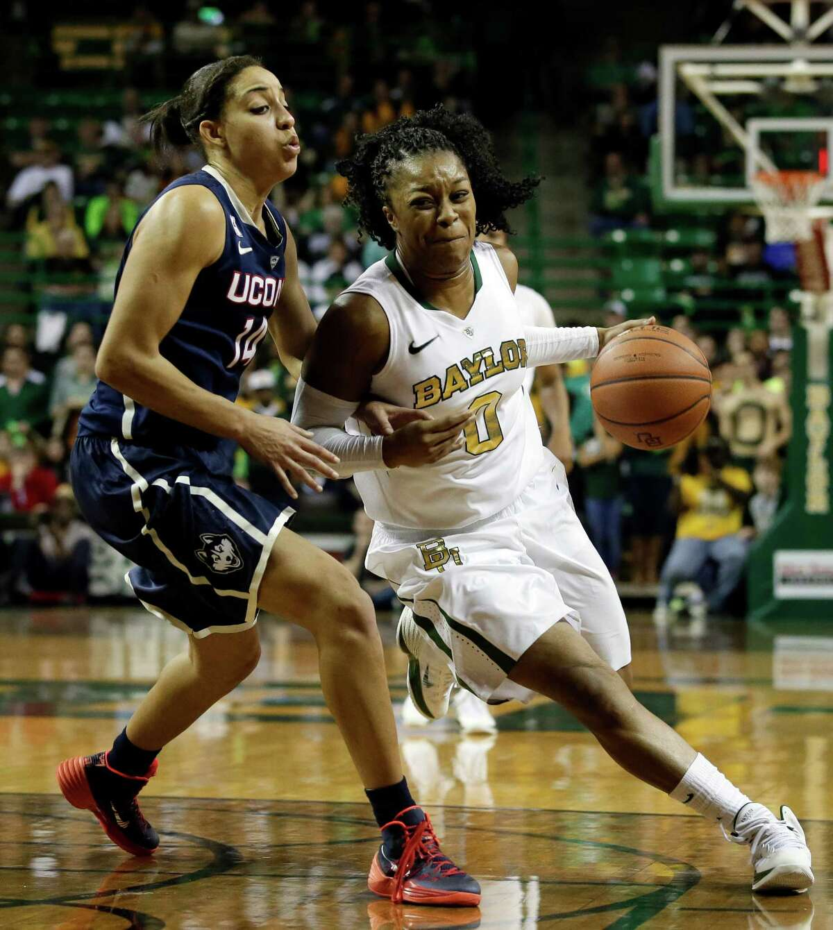 Connecticut's Bria Hartley, left, defends against a drive by Baylor's Odyssey Sims (0) in the second half of an NCAA college basketball game, Monday, Jan. 13, 2014, in Waco, Texas. Sims had a game-high 20-points in the 66-55 Baylor loss.