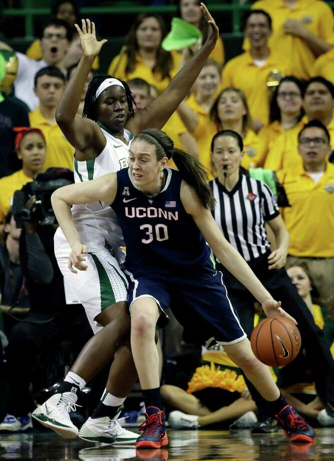 Connecticut forward Breanna Stewart (30) moves around Baylor's Sune Agbuke, left, for a shot opportunity in the second half of an NCAA college basketball game, Monday, Jan. 13, 2014, in Waco, Texas. Stewart lead her team in scoring with 18-points, in the 66-55 win over Baylor. Photo: Tony Gutierrez, AP / Associated Press