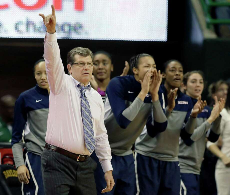 Connecticut head coach Geno Auriemma instructs the defense as the bench cheers late in the second half of an NCAA college basketball game against Baylor, Monday, Jan. 13, 2014, in Waco, Texas. Connecticut won 66-55. Photo: Tony Gutierrez, AP / Associated Press