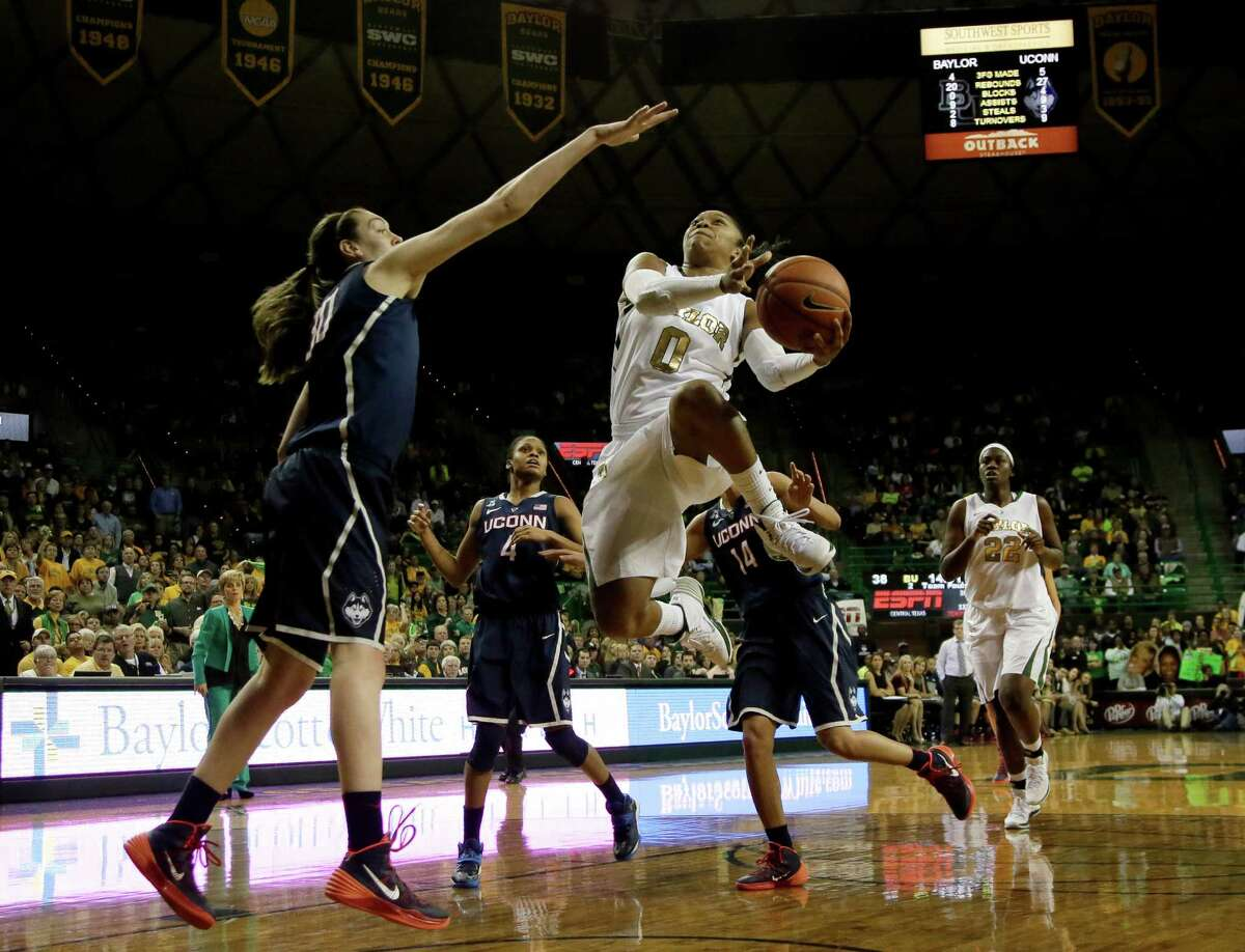 Connecticut's Breanna Stewart, left, defends as Baylor's Odyssey Sims (0) goes up for a shot in the second half of an NCAA college basketball game, Monday, Jan. 13, 2014, in Waco, Texas. Sims lead all scoring with 20-points in the 66-55 Baylor loss.