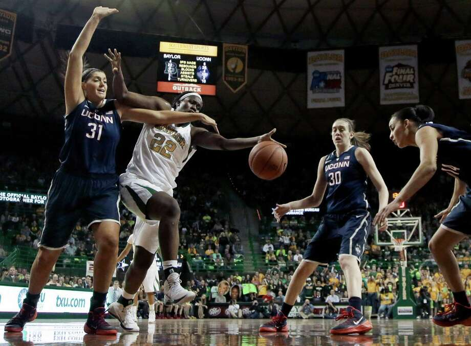 Connecticut's Stefanie Dolson (31), Breanna Stewart (30), and Bria Hartley, right, combine to win a rebound against Baylor's Sune Agbuke (22) in the second half of an NCAA college basketball game, Monday, Jan. 13, 2014, in Waco, Texas. Connecticut won 66-55. Photo: Tony Gutierrez, AP / Associated Press