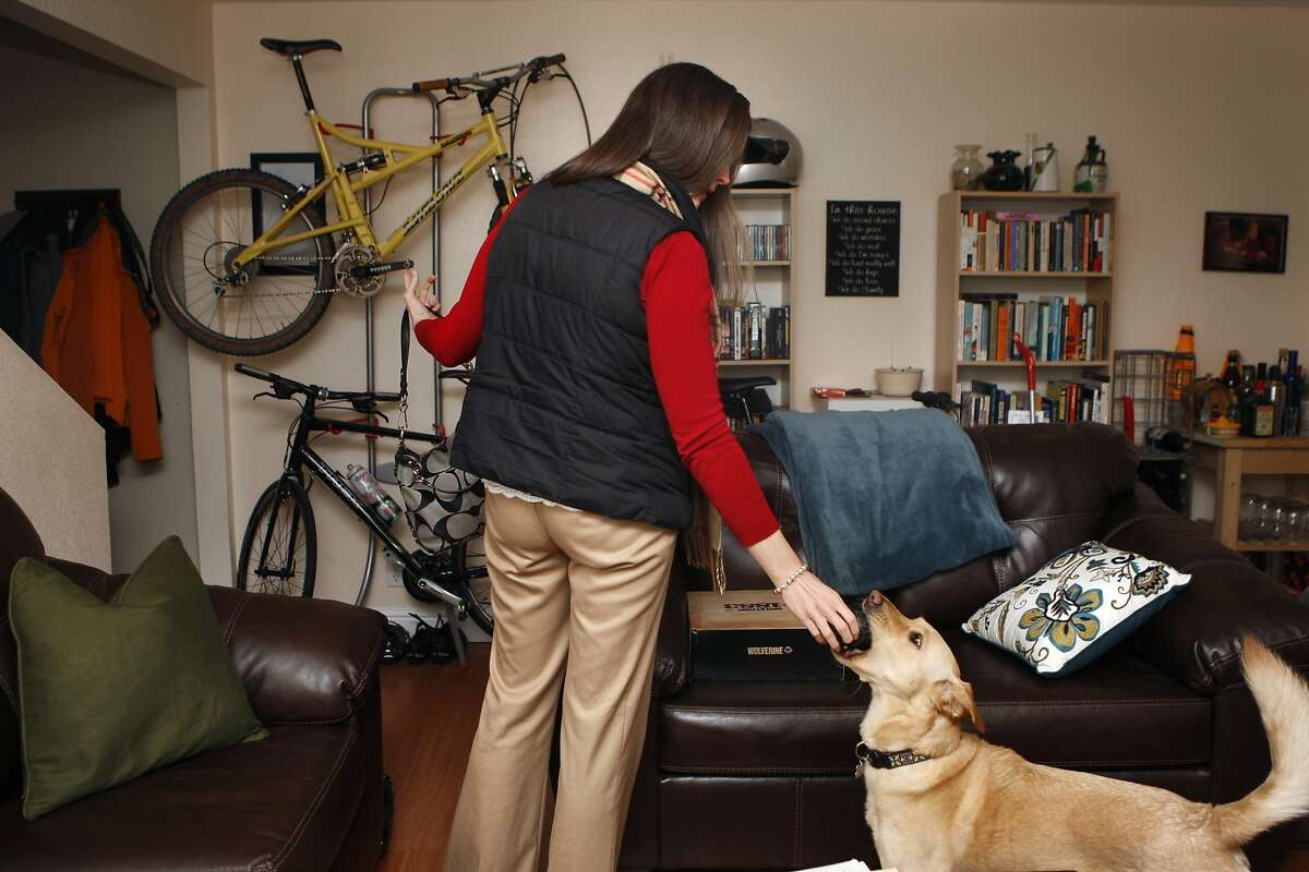 Kelly Weekes gives Ally a treat before leaving for work in Concord, Calif., on Monday, January 13, 2014.