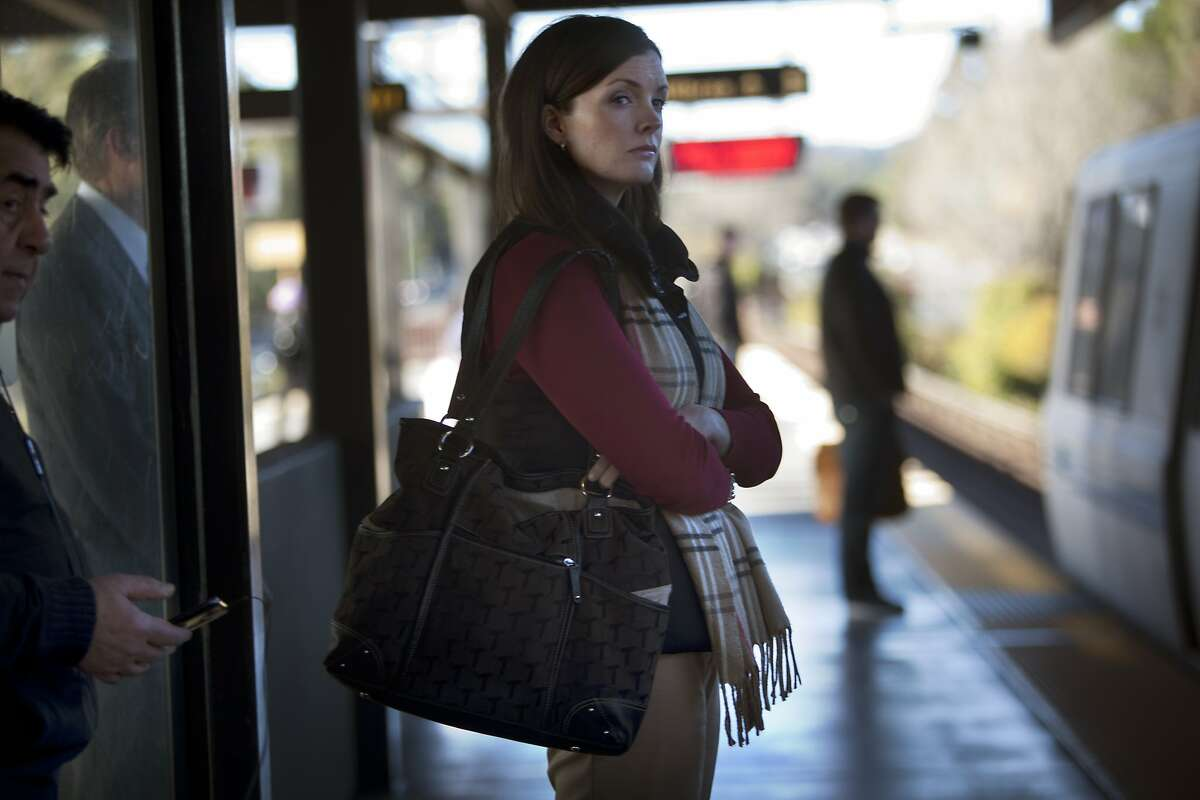 Kelley Weekes catches a train at the Bart station in Lafayette, Calif., on Monday, January 13, 2014. She is meeting a client at the Transamerica building in San Francisco.