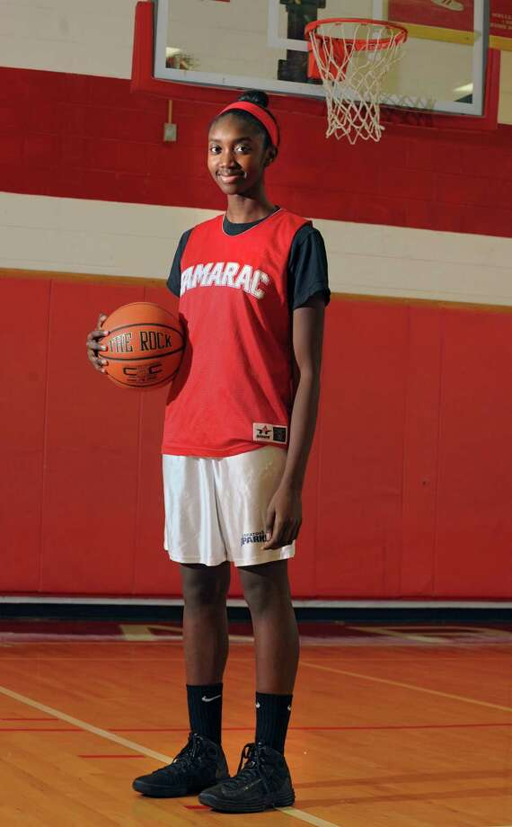 Tamarac senior center Adiya Henderson poses for a photo before basketbal practice on Monday, Jan. 13, 2014 in Clums Corners, N.Y. Adiya is the daughter of former Siena center Monte Henderson. (Lori Van Buren / Times Union) Photo: Lori Van Buren / 00025339A