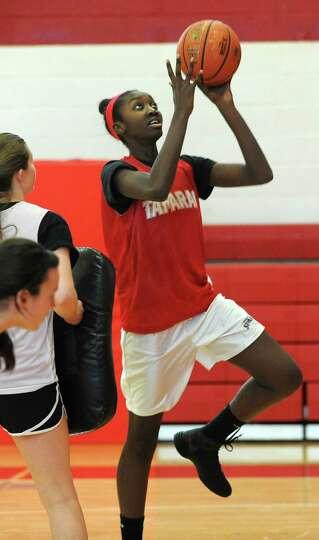 Tamarac senior center Adiya Henderson makes a layup during a drill at basketbal practice on Monday,