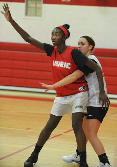 Tamarac senior center Adiya Henderson, left, looks for the pass under the basket during a drill at b