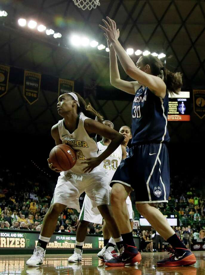 Baylor's Nina Davis (13) comes down with an offensive rebound in front of Connecticut's Breanna Stewart (30) in the second half of an NCAA college basketball game, Monday, Jan. 13, 2014, in Waco, Texas. Davis collected 17 rebounds in the 66-55 Baylor loss. Photo: Tony Gutierrez, AP / Associated Press