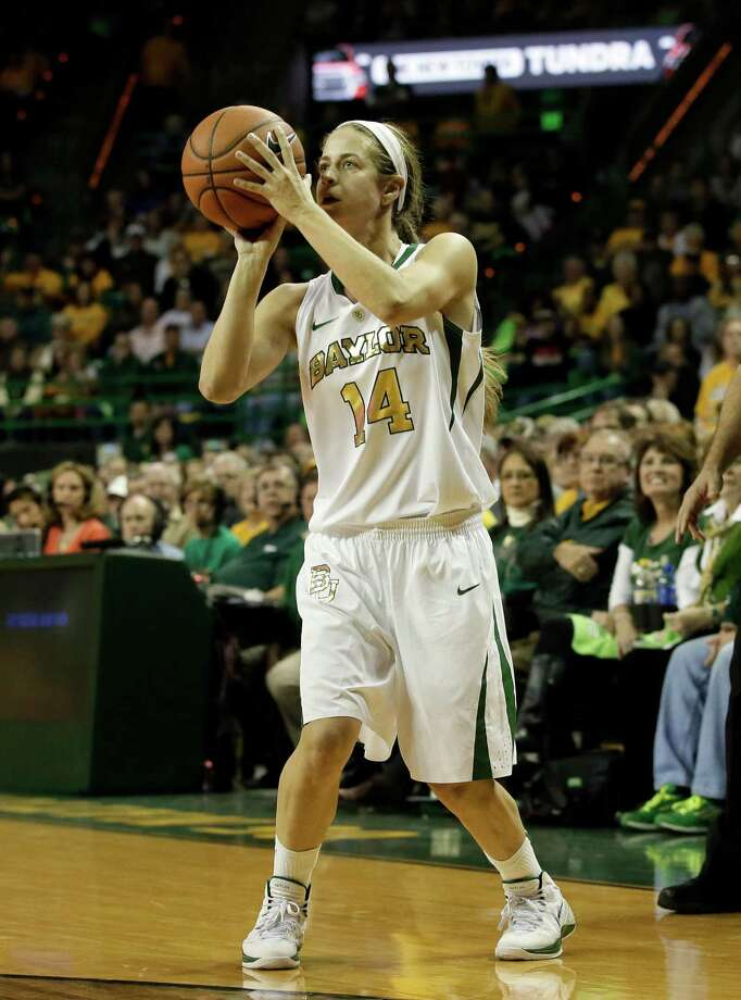 Baylor's Makenzie Robertson (14) attempts a three-point basket in the second half of an NCAA college basketball game against Connecticut, Monday, Jan. 13, 2014, in Waco, Texas. Connecticut won 66-55. Photo: Tony Gutierrez, AP / Associated Press