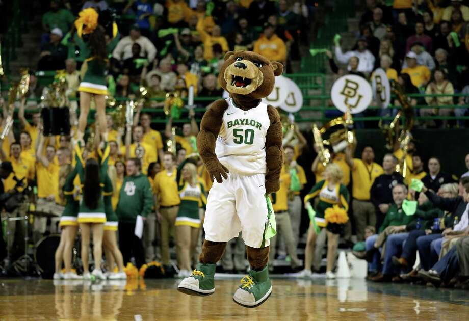 "The Baylor mascot ""Bruiser"" motivates the crowd during the second half of an NCAA college basketball game against Connecticut, Monday, Jan. 13, 2014, in Waco, Texas. Connecticut won 66-55. Photo: Tony Gutierrez, AP / Associated Press"