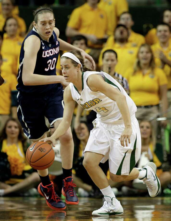 Baylor's Makenzie Robertson (14) comes away with a rebound as Connecticut's Breanna Stewart (30) watches in the second half of an NCAA college basketball game, Monday, Jan. 13, 2014, in Waco, Texas. Connecticut won 66-55. Photo: Tony Gutierrez, AP / Associated Press