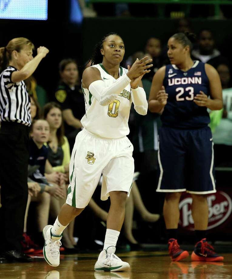 Baylor Bears' Odyssey Sims (0) applauds after Connecticut's Kaleena Mosqueda-Lewis (23) was charged with a foul in the first half of an NCAA college basketball game, Monday, Jan. 13, 2014, in Waco, Texas. Connecticut won 66-55. Photo: Tony Gutierrez, AP / Associated Press