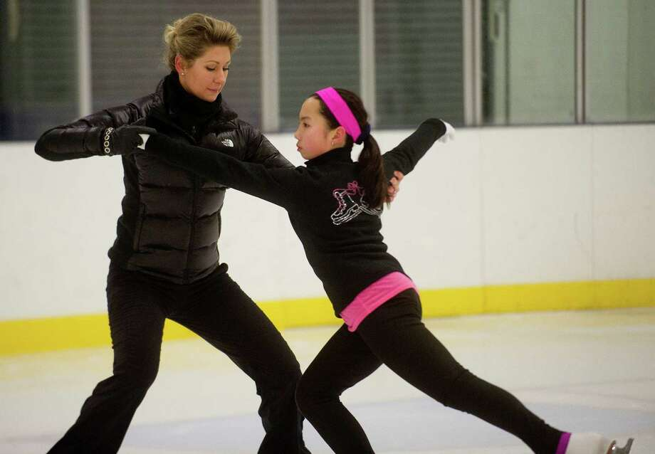 Caitlin Chan, 11, takes a figure-skating lesson with her instructor, Ekaterina Gvozdkova, at Twin Rinks in Stamford. Photo: Lindsay Perry / Stamford Advocate