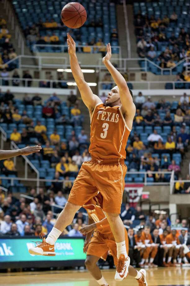 Texas' Javan Felix (3) looks to shoot during the first half of an NCAA college basketball game Monday, Jan. 13, 2014, in Morgantown, W.Va. (AP Photo/Andrew Ferguson) Photo: Andrew Ferguson, Associated Press / FR171051 AP