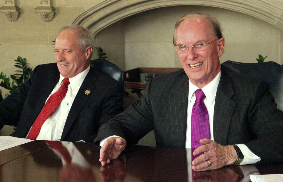 County Judge Nelson Wolff (right) and his challenger, Precinct 4 Commissioner Tommy Adkisson, discuss their goals with the newspaper's Editorial Board. Photo: Juanito Garza / San Antonio Express-News / San Antonio Express-News