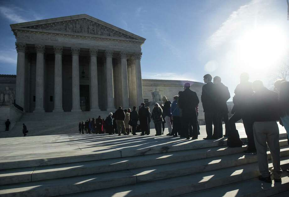 People wait in line to enter the U.S. Supreme Court on the first day of January sessions. The court declined to hear an appeal from Arizona officials seeking to revive a stricter abortion law. Photo: Gabriella Demczuk / New York Times / NYTNS