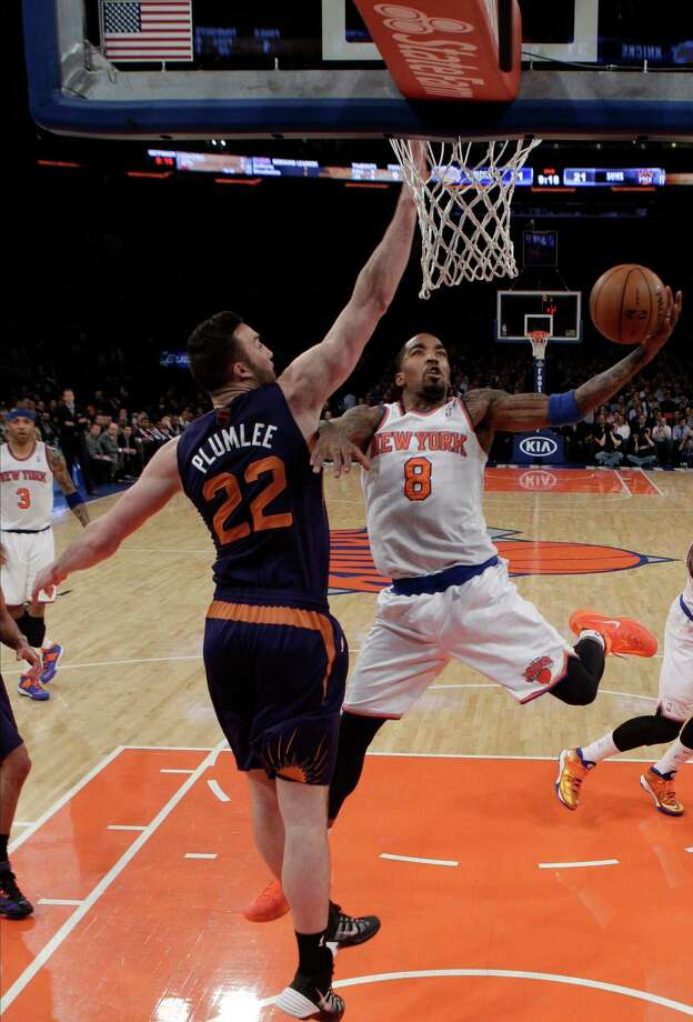 New York Knicks' J.R. Smith (8) drives past Phoenix Suns' Miles Plumlee (22) during the first half of an NBA basketball game, Monday, Jan. 13, 2014, in New York. (AP Photo/Frank Franklin II) ORG XMIT: MSG111 Photo: Frank Franklin II / AP