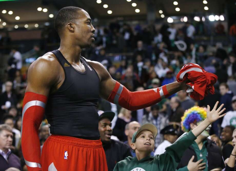 Dwight Howard offers his jersey to a Boston fan after the Rockets defeated the Celtics. Photo: Elise Amendola, Associated Press