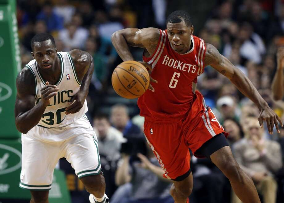 Rockets forward Terrence Jones chases down a loose ball against the Celtics. Photo: Elise Amendola, Associated Press