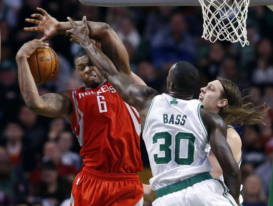 Rockets forward Terrence Jones hauls in a rebound against Brandon Bass and Kelly Olynyk of the Celtics Photo: Elise Amendola, Associated Press