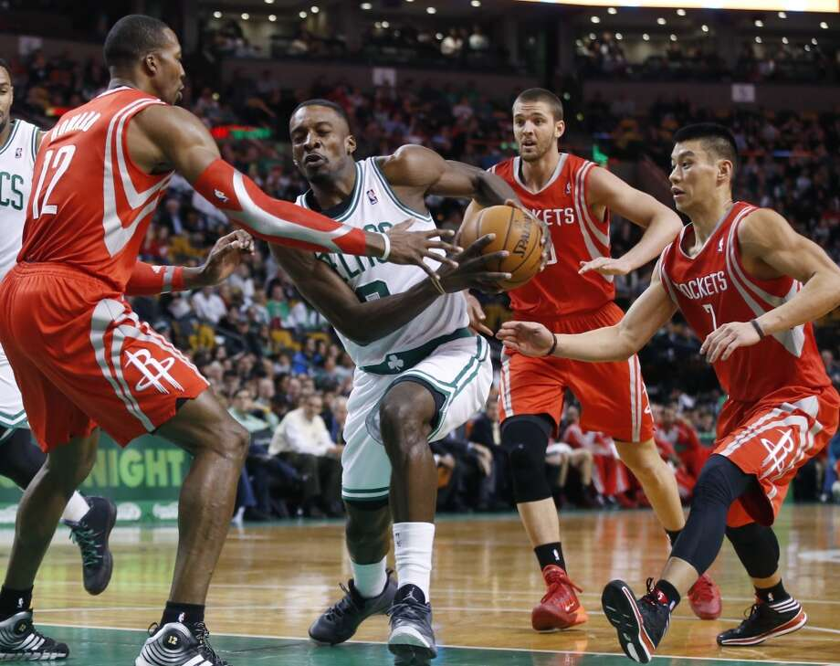 Jeff Green of the Celtics drives against Rockets center Dwight Howard. Photo: Elise Amendola, Associated Press