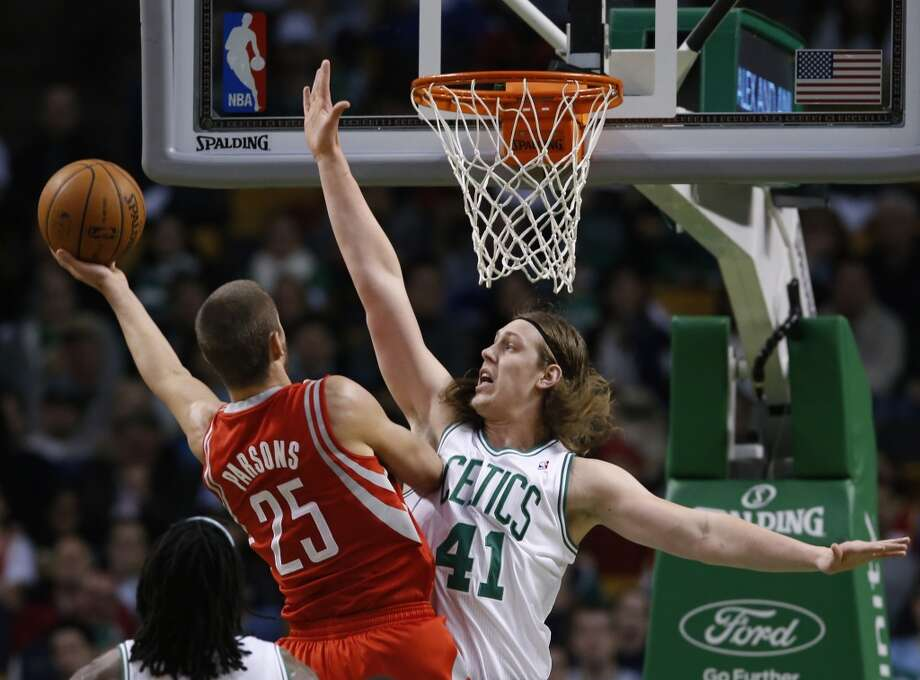 Rockets forward Chandler Parsons attempts a close basket as Kelly Olynyk of the Celtics defends. Photo: Elise Amendola, Associated Press