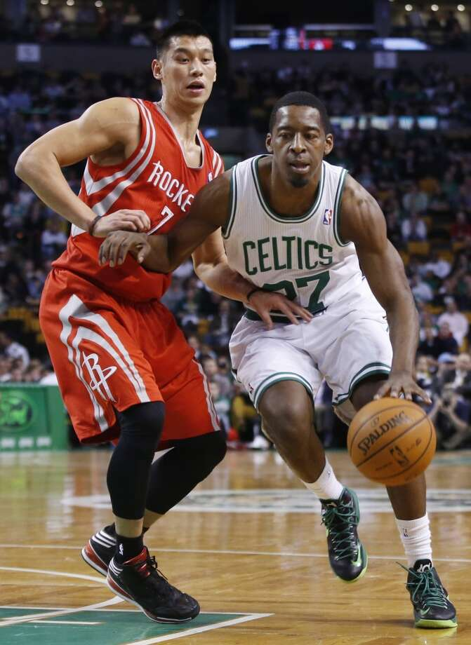 Celtics guard Jordan Crawford drives against Jeremy Lin of the Rockets. Photo: Elise Amendola, Associated Press