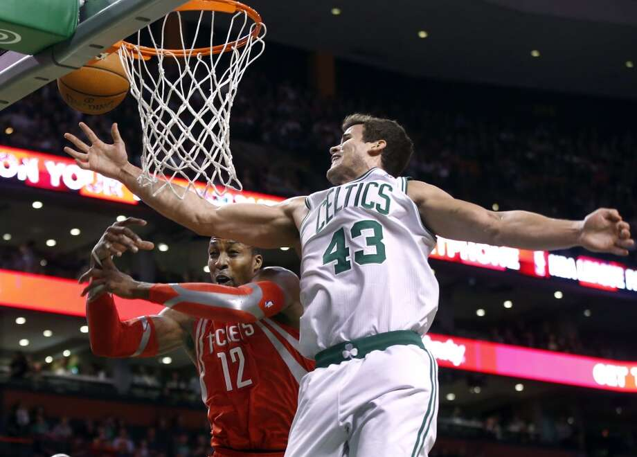 Celtics forward Kris Humphries fights for a rebound with Rockets center Dwight Howard. Photo: Elise Amendola, Associated Press