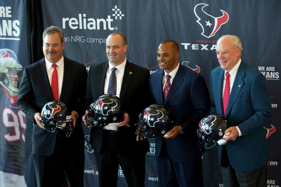 The Texans' brain trust figures to be trying to find a quarterback when they head to the NFL combine next week. Photo: Brett Coomer, Staff / © 2014  Houston Chronicle
