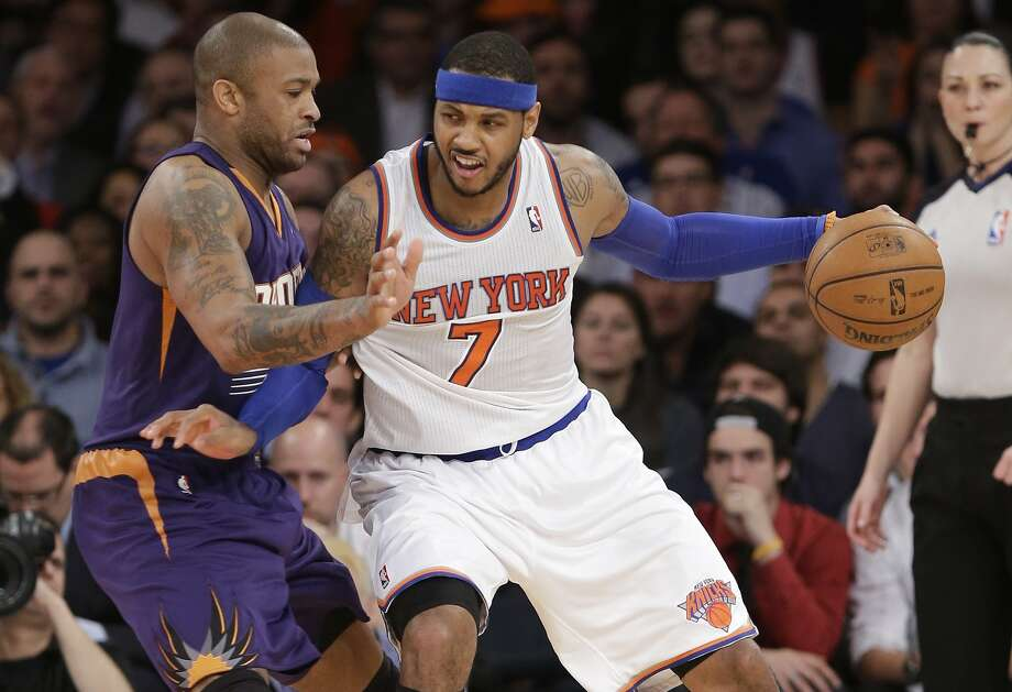 The Knicks' Carmelo Anthony (7) is defended by the Suns' P.J. Tucker in New York's overtime win. Photo: Frank Franklin II, Associated Press