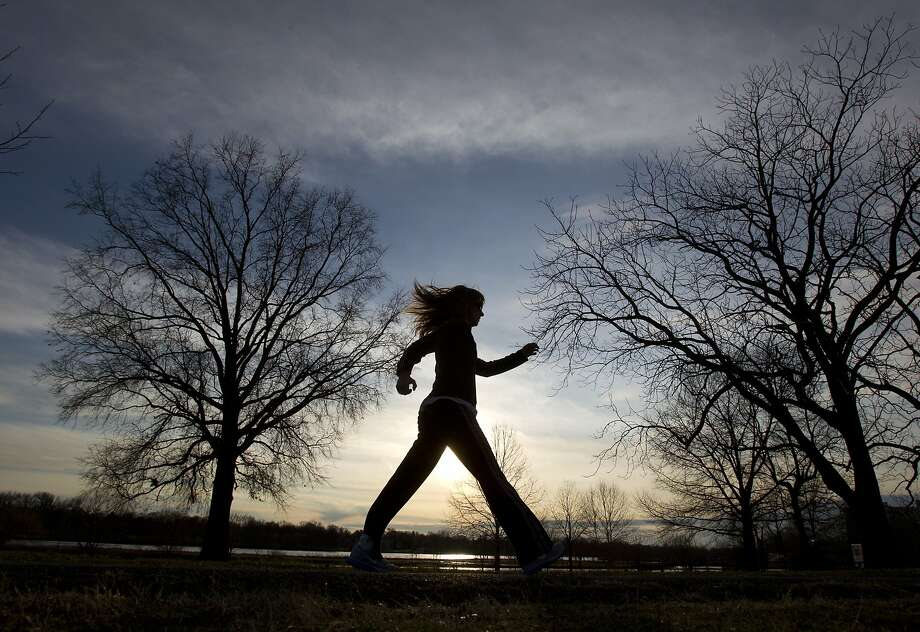 A woman power walks in Cooper River Park along Park Drive, Monday, Jan. 13, 2014, in Pennsauken Township, Pa. With temperatures in the mid-50's, many took advantage of the weather to head outside. (AP Photo/The Philadelphia Inquirer, Charles Fox) PHIX OUT; TV OUT; MAGS OUT; NEWARK OUT. MAGS OUT. Photo: Charles Fox, Associated Press