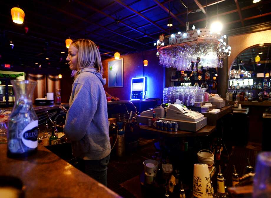 Mary Hooker tends bar at the Pacesetter Lounge on Monday night. Pacesetter Lounge on Phelan Boulevard is the CAT5 Bar of the Week for January 9, 2014. The lounge shut down last October but reopened just a few weeks later. Photo taken Monday, 12/30/13 Jake Daniels/@JakeD_in_SETX